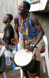 Sayon playing joyously at a fete in Simbaya Gare, Conakry, Guinea