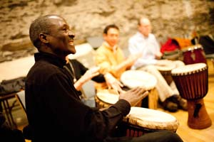 Sayon Camara teaches the djembe accompaniment in class, Woodstock VT.