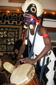 Sayon plays in his djembefola regalia.