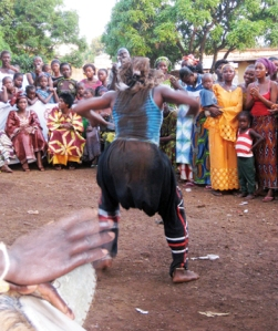 Saran Conde dancing traditionally at a marriage fete in Guinea.