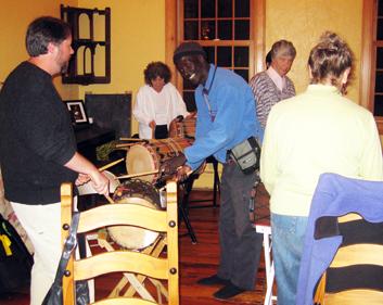 Sayon teaches dununs at a workshop in Bath, ME