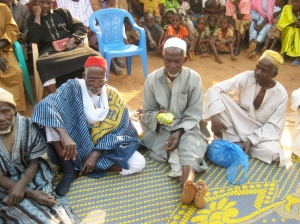 The new chief of Kouya Sidia seated between the former chief and his younger brother.
