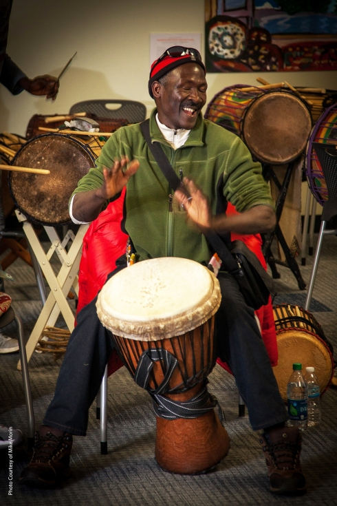 Sayon playing the djembe at a workshop.